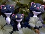 Black Whimsy Cats  Big--22 mm; small--18 mm.  The two sizes are very well matched.